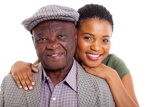 african daughter and senior father close up stock photo