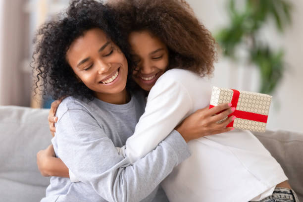 African daughter congratulating mother with birthday relative people embracing Close up cute african teen daughter congratulate mom with mother day, relative people embracing, mom feels gratitude. Celebration of anniversary or birthday, family life events and best wishes concept birthday wishes for daughter stock pictures, royalty-free photos & images