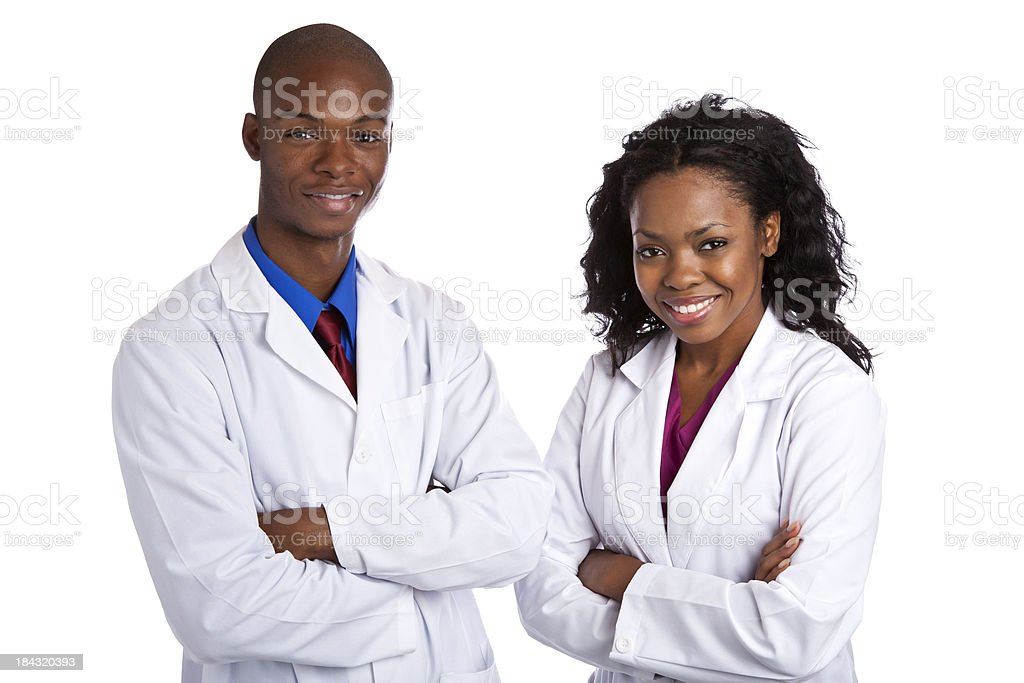 African decent couple wearing lab coats arms crossed stock photo