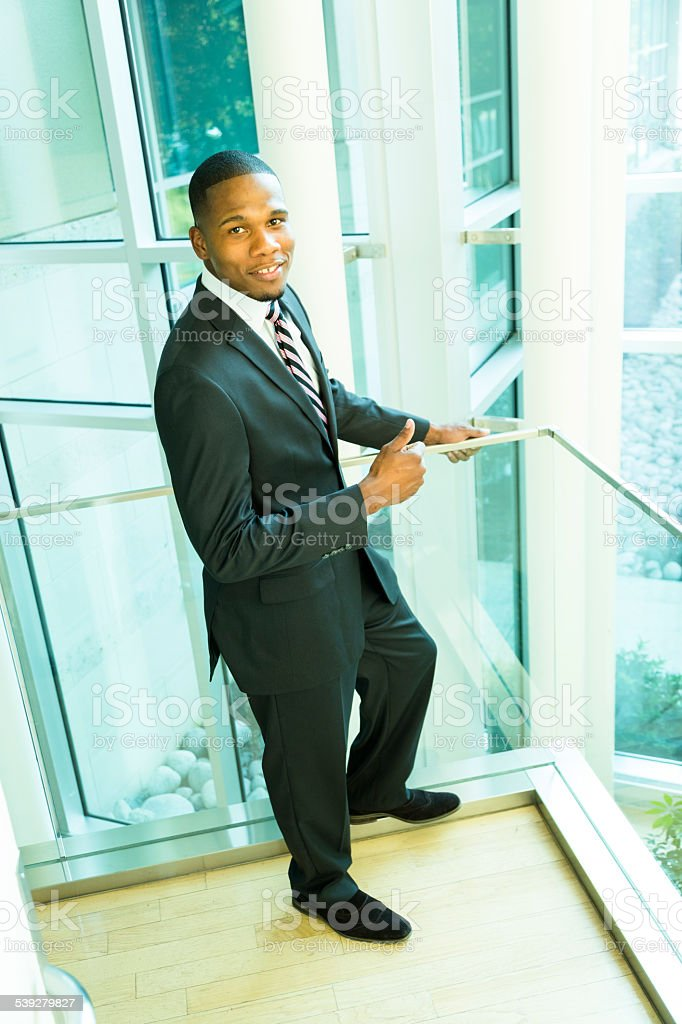 African descent business man in office building. Suit and tie. stock photo