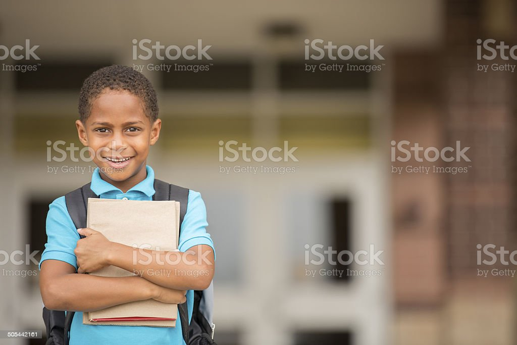 African descent child, boy ready for a school day. stock photo