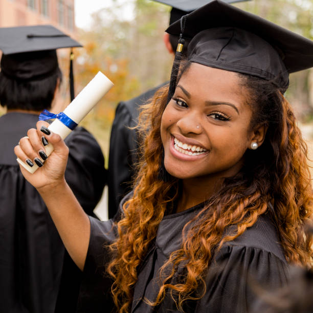 African descent college student at college graduation. stock photo