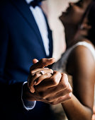 African descent couple dancing at wedding celebration