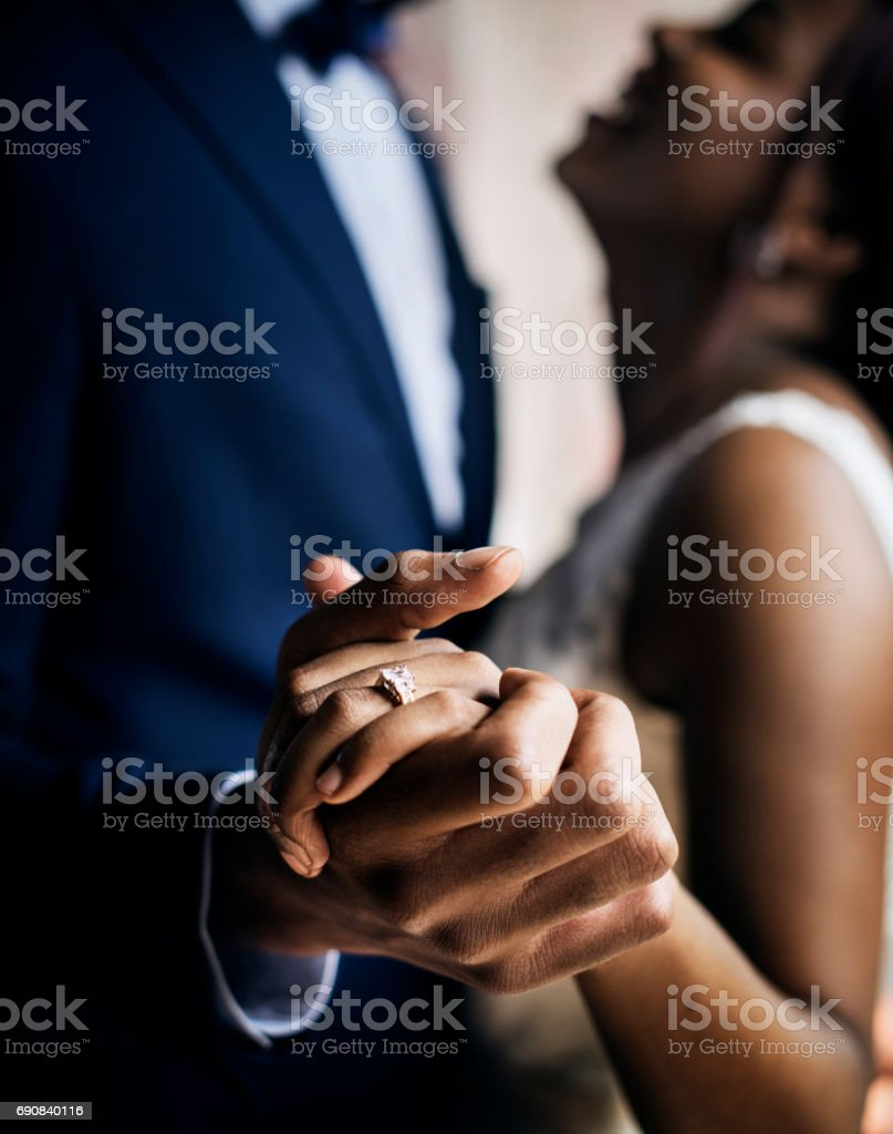 African descent couple dancing at wedding celebration stock photo