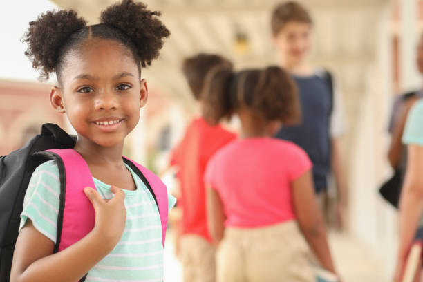 African descent, elementary age girl on school campus. stock photo