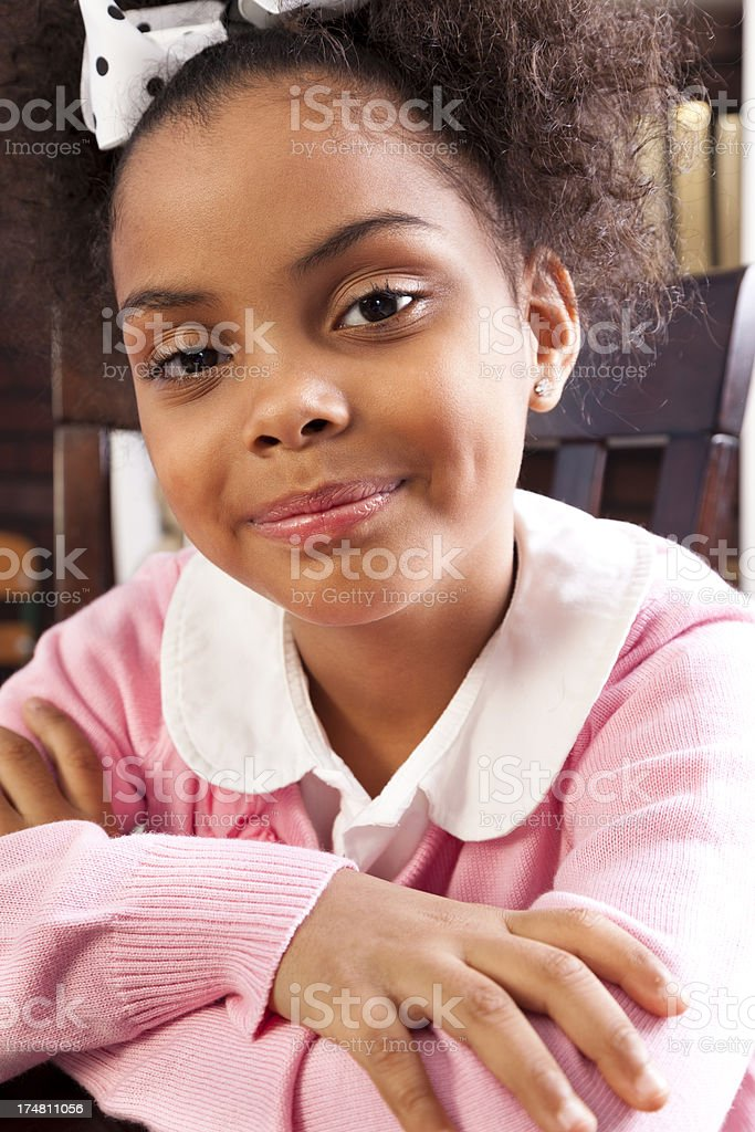 African descent elementary girl 7-8 smiling looking into camera. royalty-free stock photo