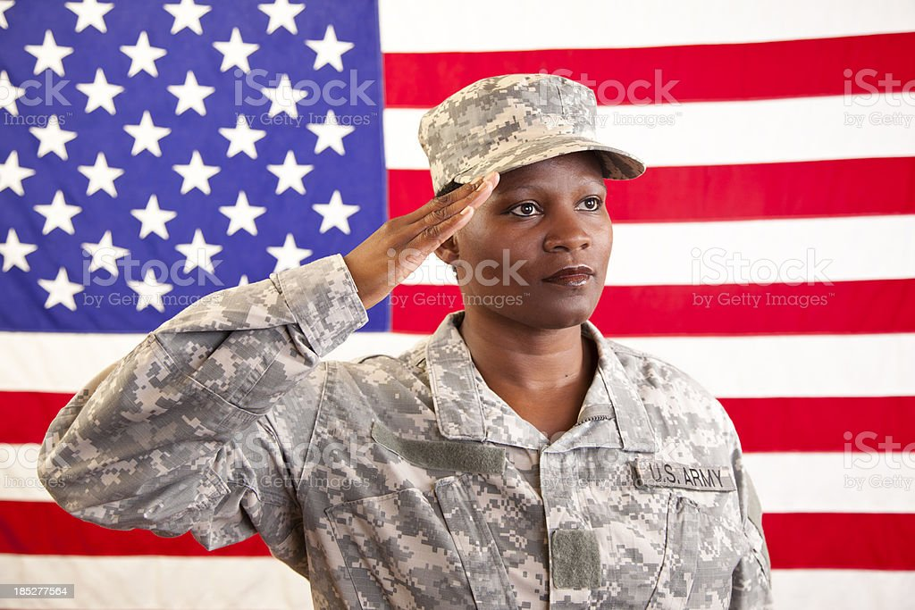 African descent female in military uniform saluting American flag - Stock  image . c019cb27960