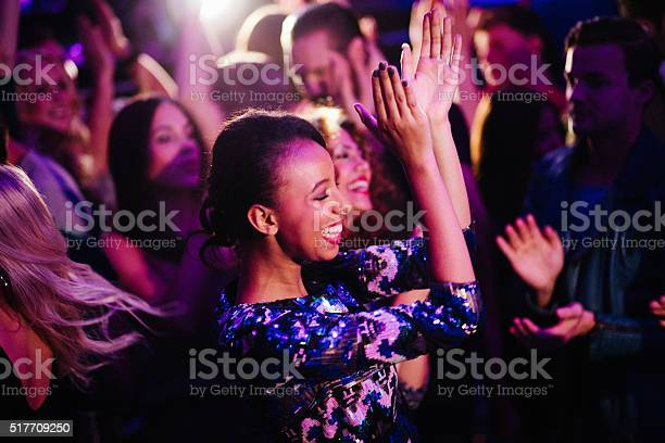 African descent girl enjoys dancing with friends in nigh club picture id517709250?b=1&k=6&m=517709250&s=612x612&h=9usutjuclqp0cb t9wu04qs6mim781nt8lqoop vvgg=