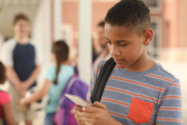 African descent, junior high age boy on school campus. stock photo