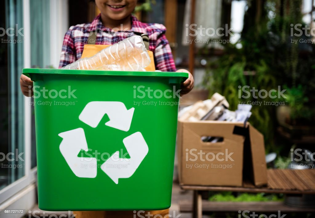African Descent Kid Holding Recycling Box of Plastic Bottles ストックフォト