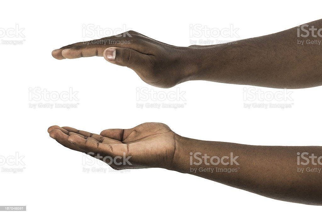 African descent man with palms facing up and down stock photo