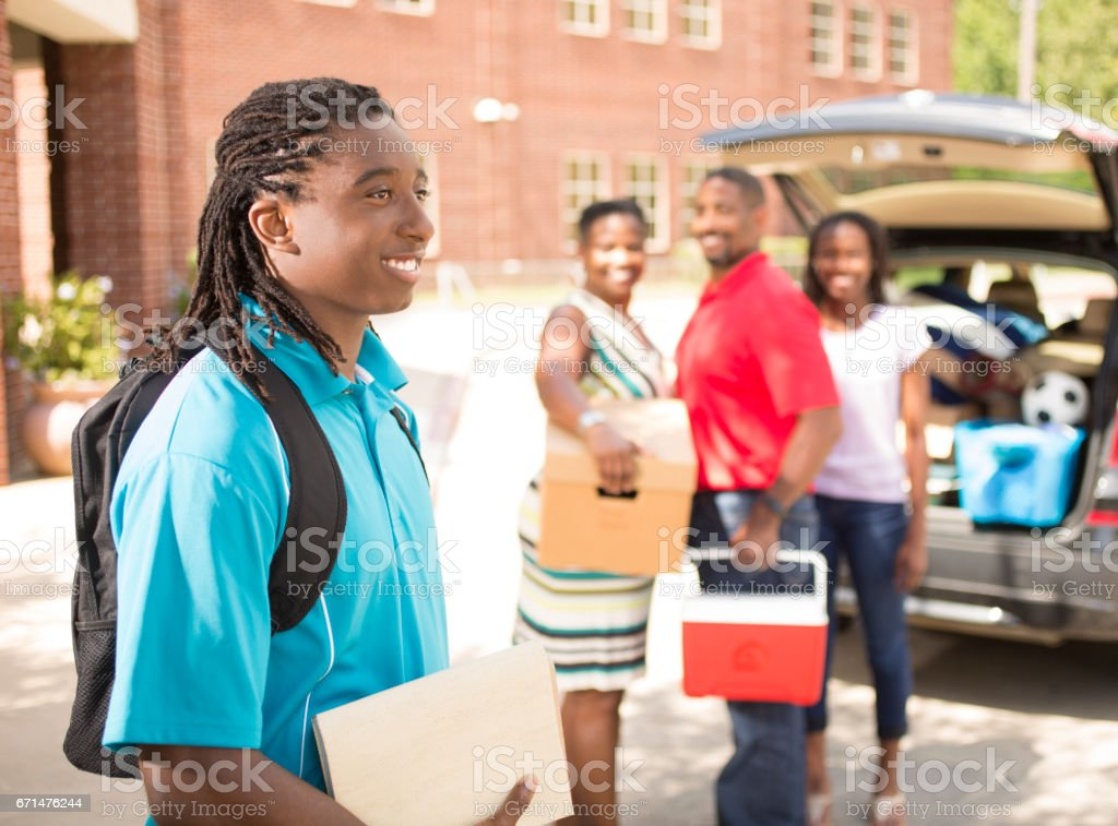 African Descent Teenage Boy Moves Into College Dorm Stock Photo - Download  Image Now