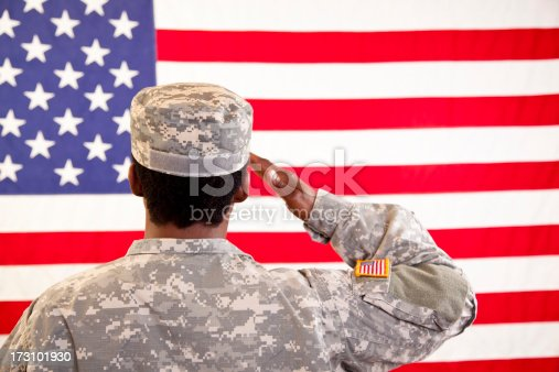 Female in military uniform saluting American flag.  MORE LIKE THIS... in lightboxes below.