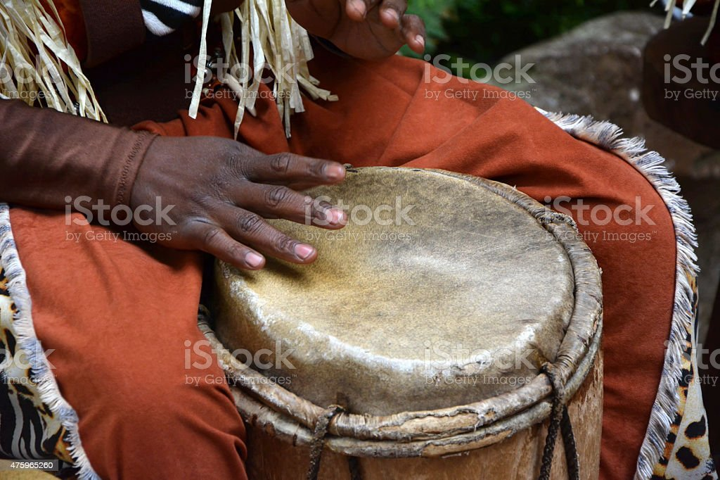 African djembe drummer in action stock photo