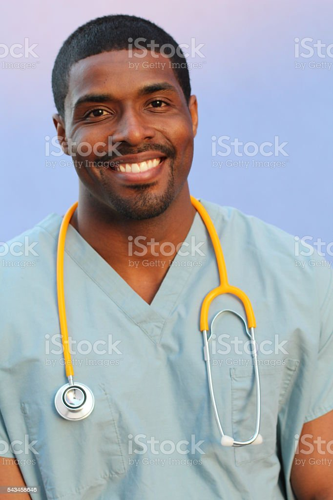 African doctor isolated on blue background stock photo