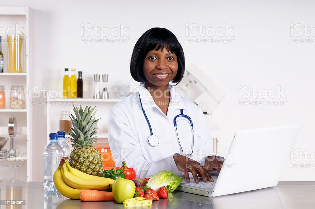African doctor providing dietary advice stock photo