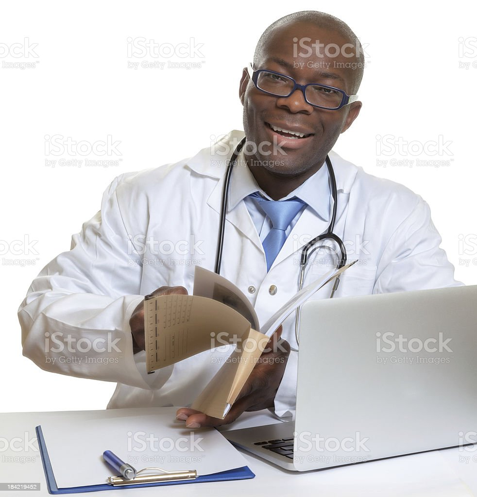 African doctor reading medical records royalty-free stock photo