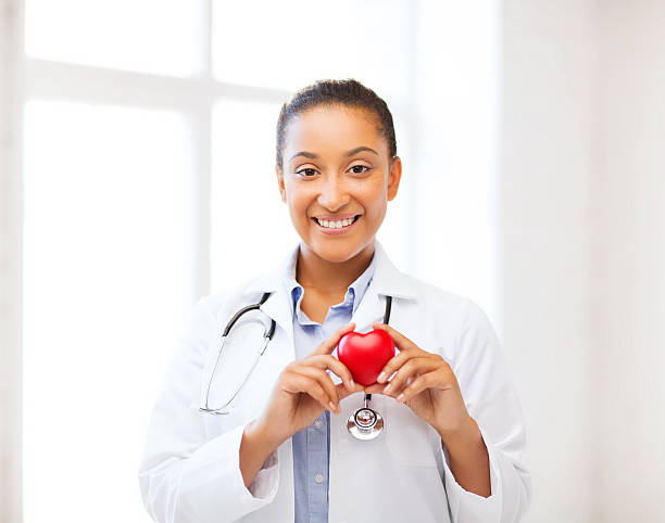 african doctor with heart stock photo
