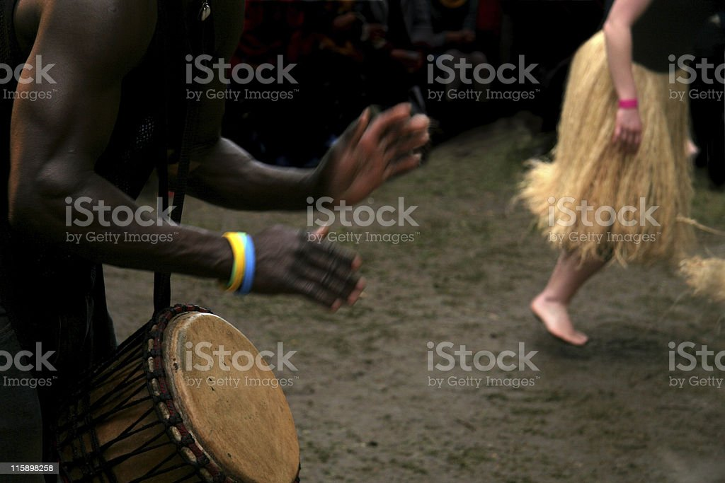 African Drummer and woman dancing during carnival royalty-free stock photo