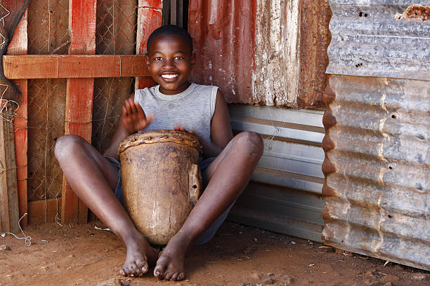 African drummer boy stock photo
