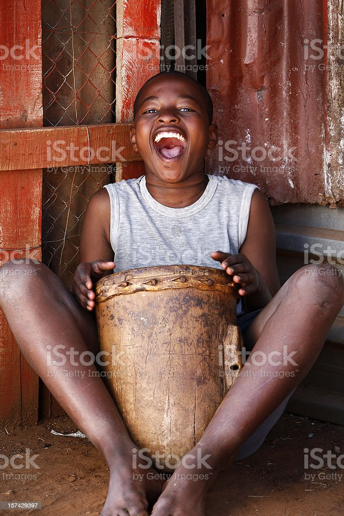 African drummer boy stock photo