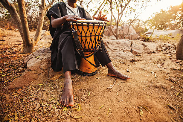 african drummer playing stock photo