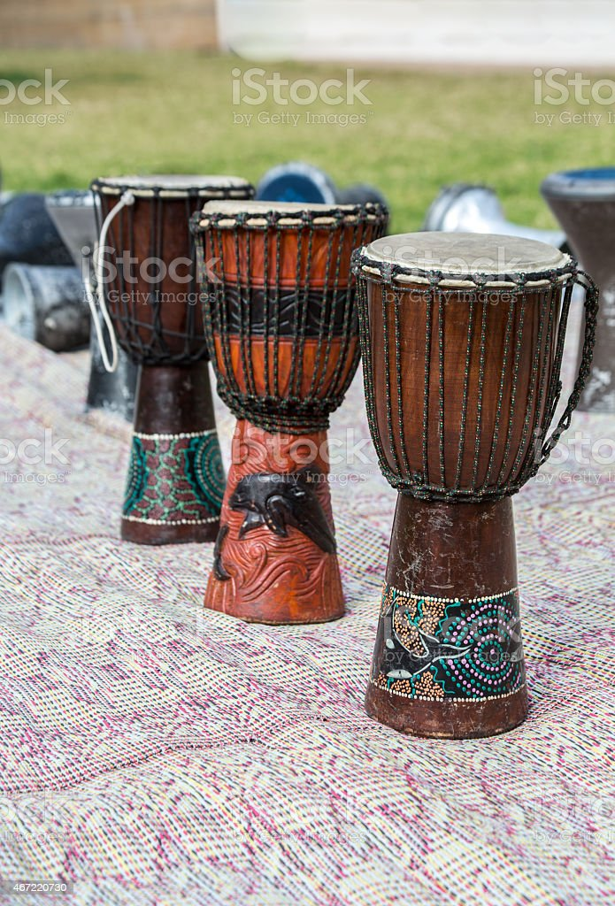 african drums on a carpet outdoors stock photo