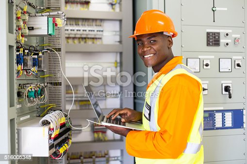 istock african electrical worker using laptop computer 516005348