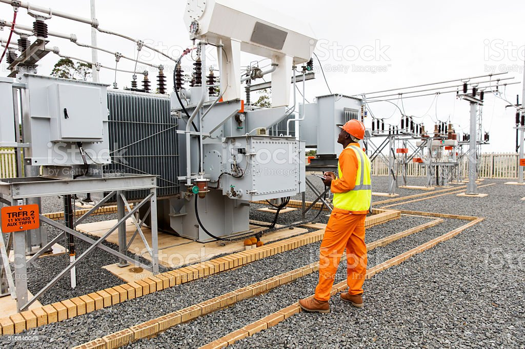 african electrician working in substation stock photo