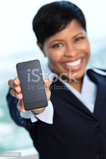 istock African ethnicity businesswoman showing front of cellphone 174795361