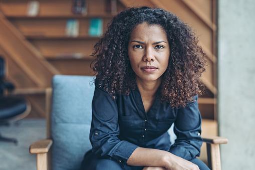 Portrait of a serious African descent businesswoman