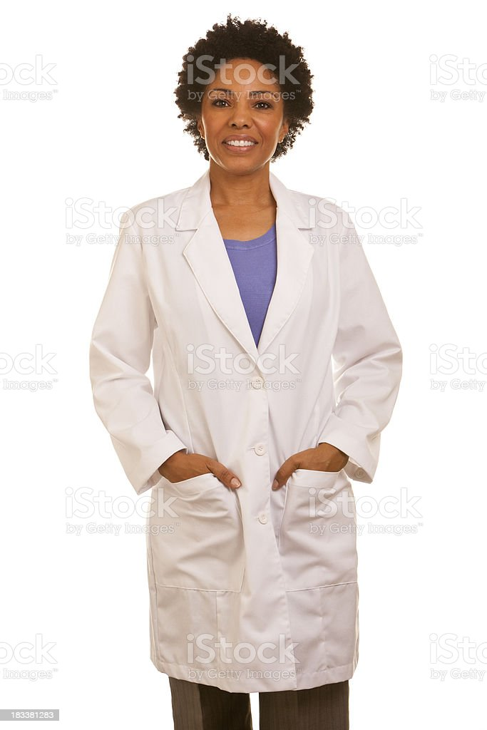 African ethnicity female wearing lapcoat with hands in pockets stock photo