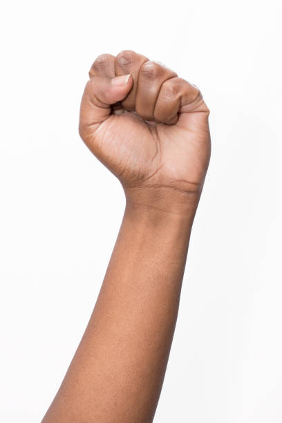 african ethnicity fist - fist stock photos and pictures