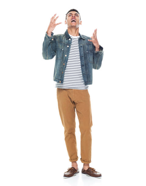 African ethnicity male standing in front of white background wearing boat shoe stock photo