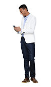 istock African ethnicity male standing in front of white background wearing jacket and using mobile phone 1222245965