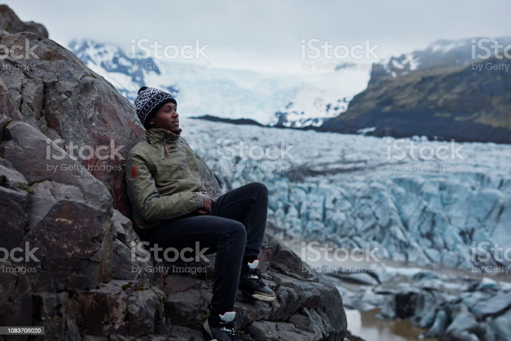 Majestic blue glacier. Man admiring the view. Serene scene