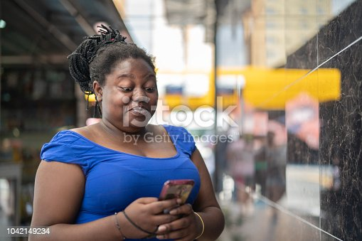 istock African Ethnicity Woman Using Mobile 1042149234