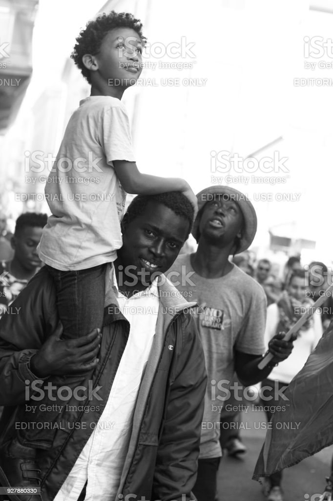 African Family during an anti-fascist parade stock photo