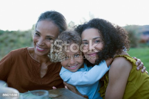 istock African family hugging 88621538