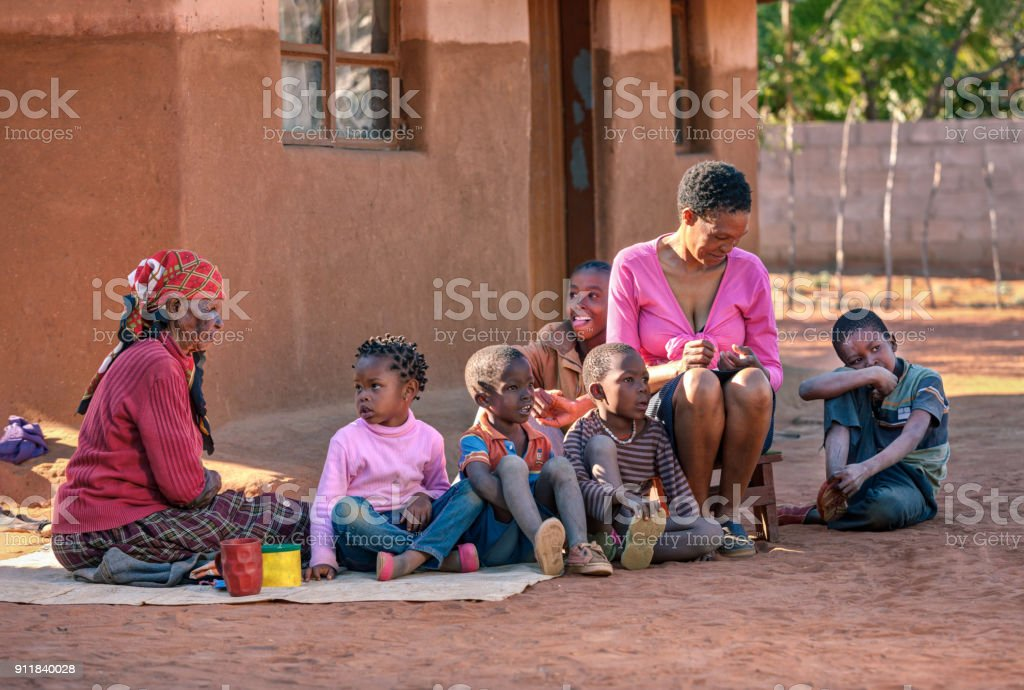 African family in front of the house stock photo