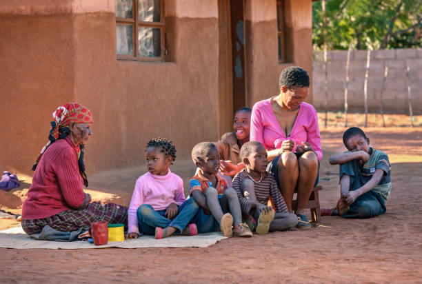 african family in front of the house - village stock pictures, royalty-free photos & images