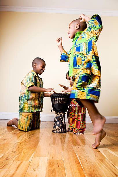 african fashion: drums and dancing children stock photo