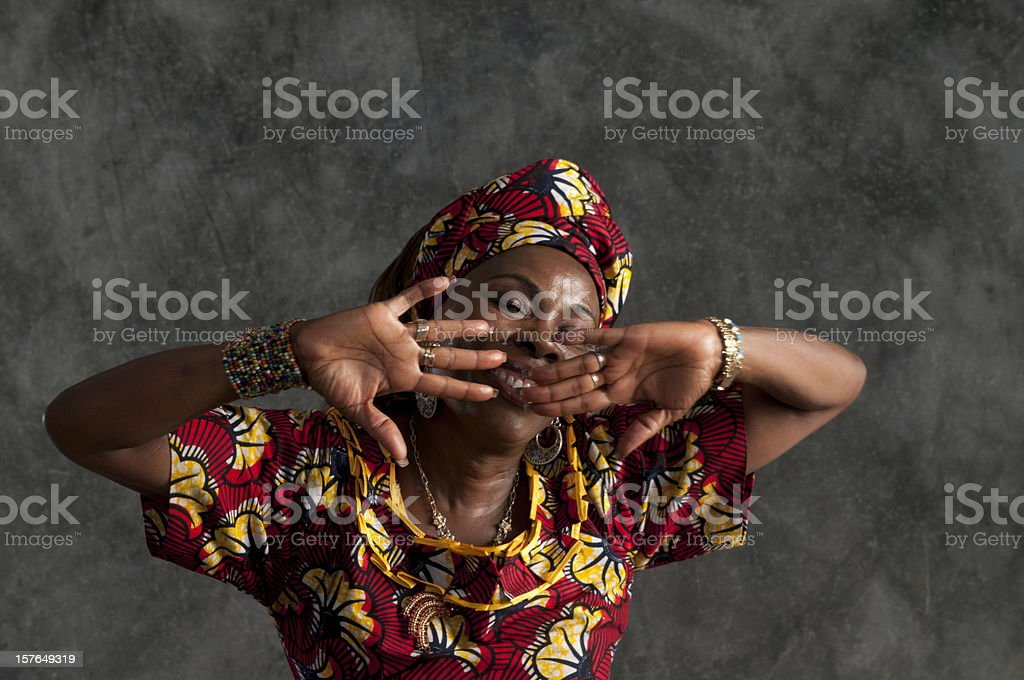 African female dancer/hands in front of face,eyes shut/close up stock photo