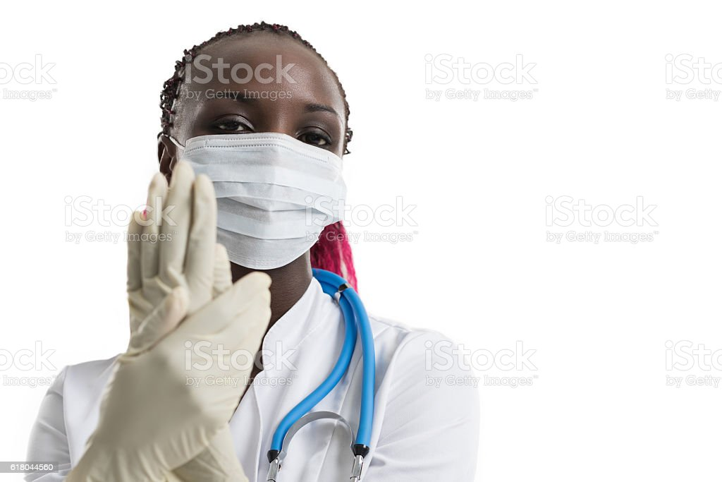 African female doctor in mask stock photo