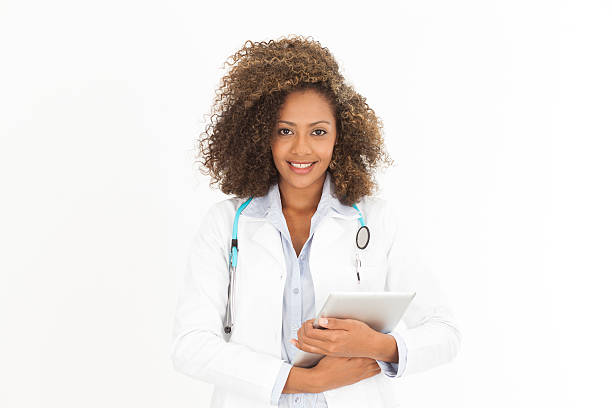 African Female doctor with annotation table medical Photo annotation stock pictures, royalty-free photos & images