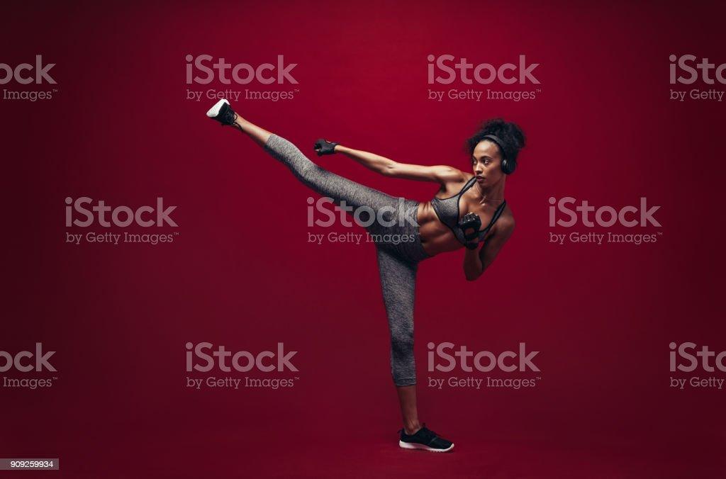 African female exercising taekwondo stock photo