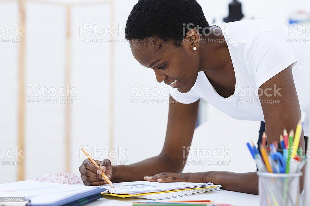 African Female Fashion Designer At Work. stock photo