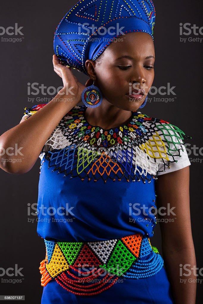 african female fashion model posing on black stock photo