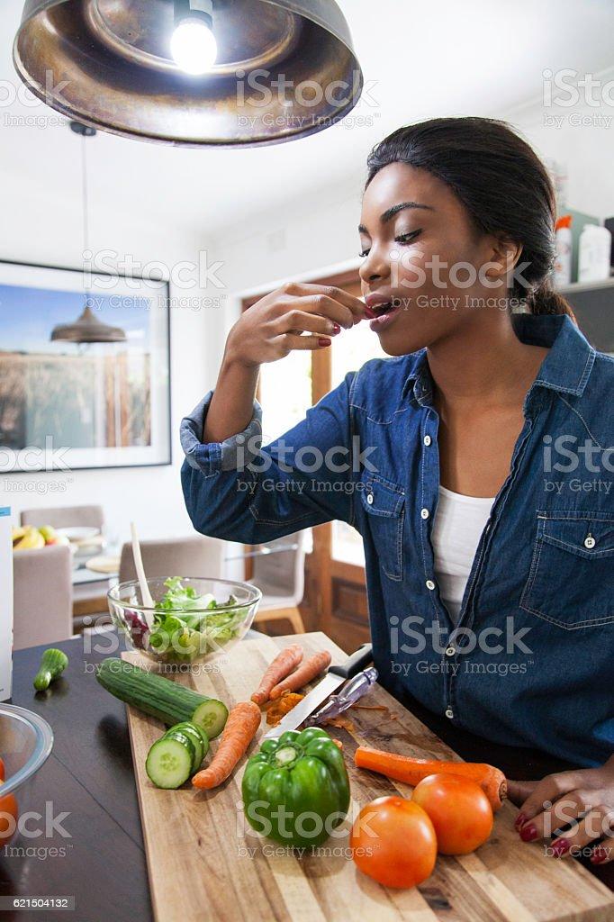 African female having a quick bit. stock photo