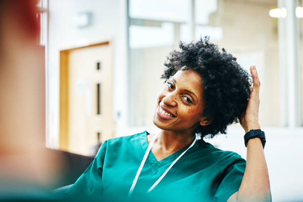 african female medic relaxing during work break - fare una pausa foto e immagini stock